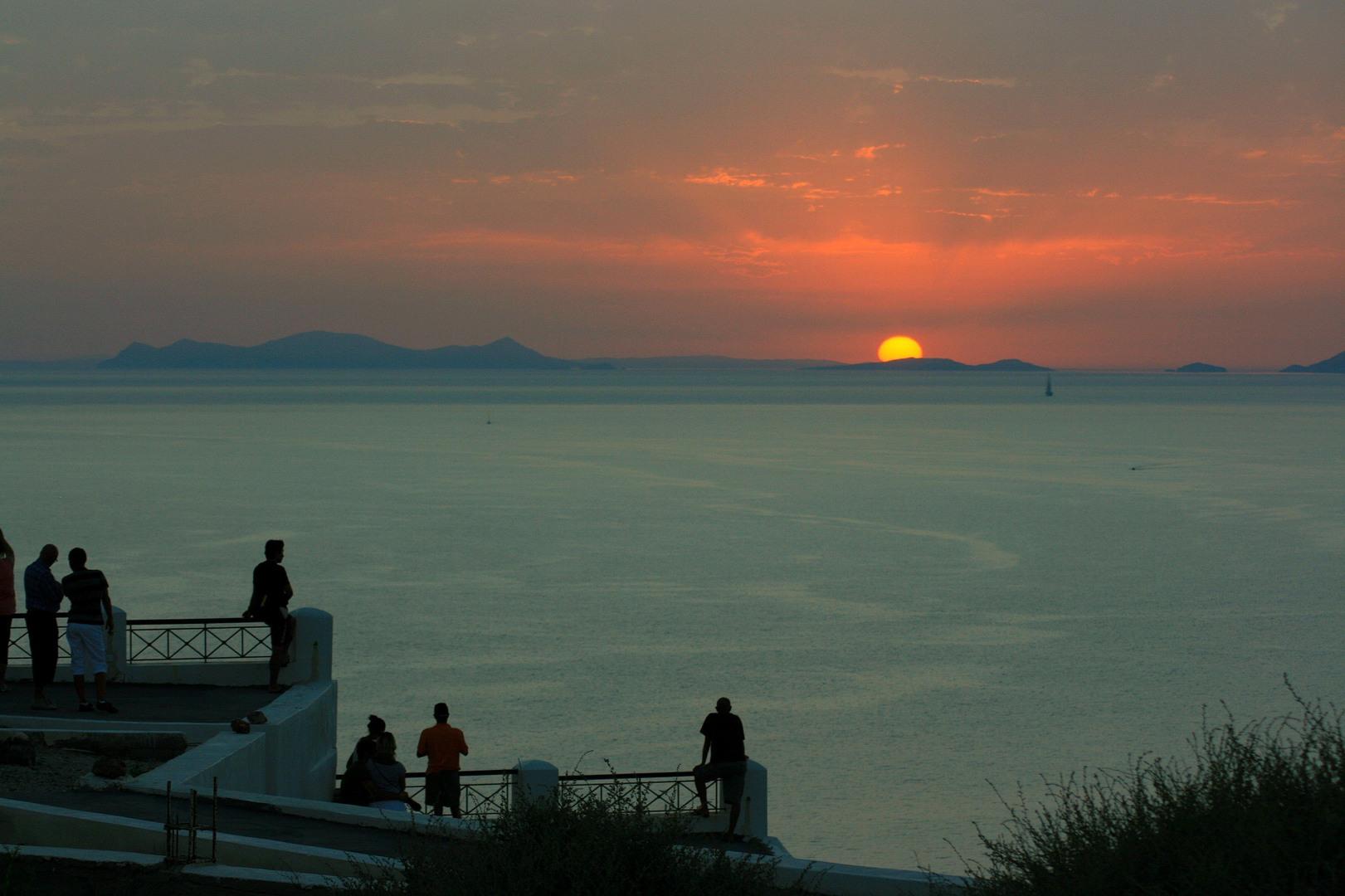 crowd watchon sunset