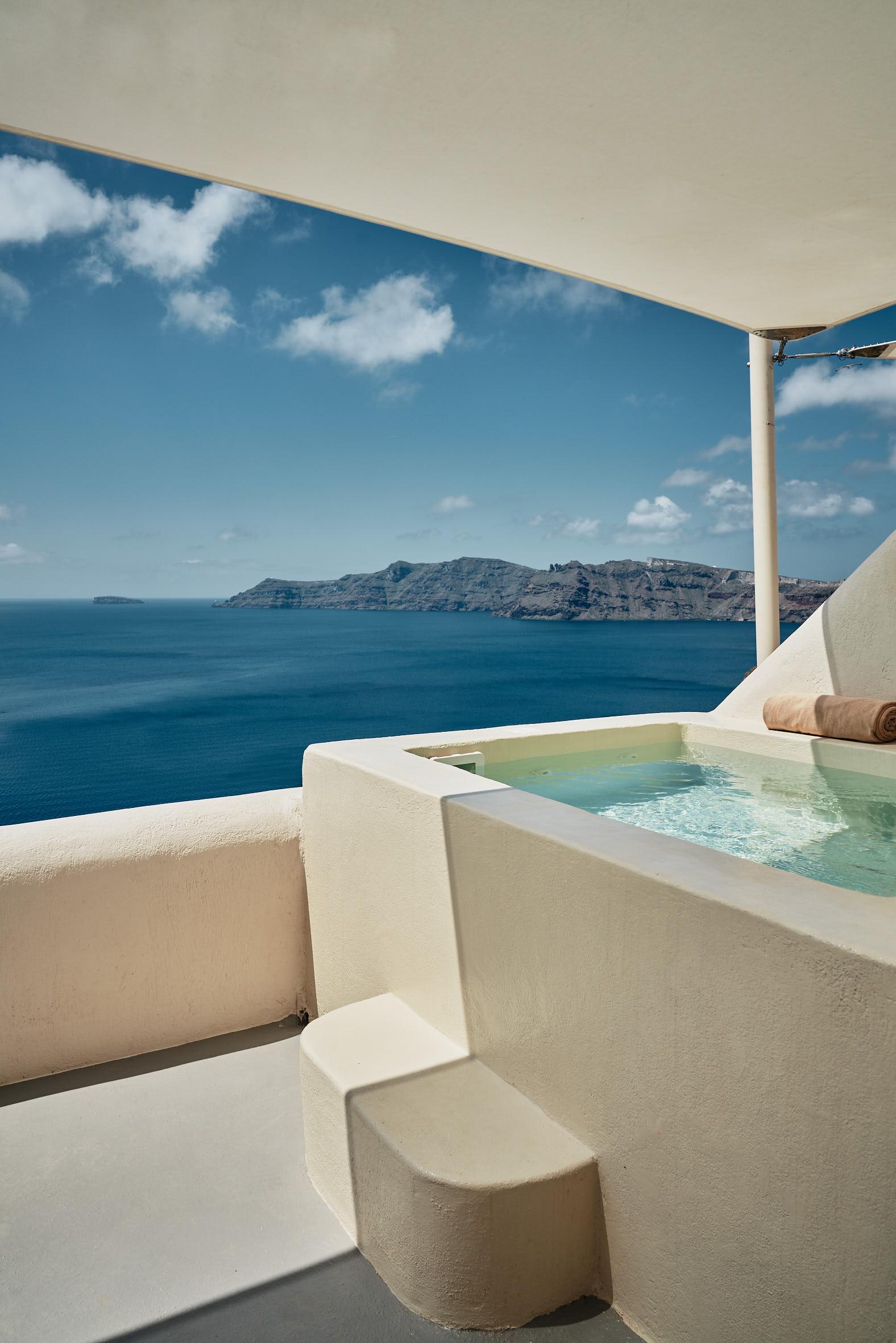 Private jacuzzi of Spiritual Suite at Mystique Hotel in Santorini