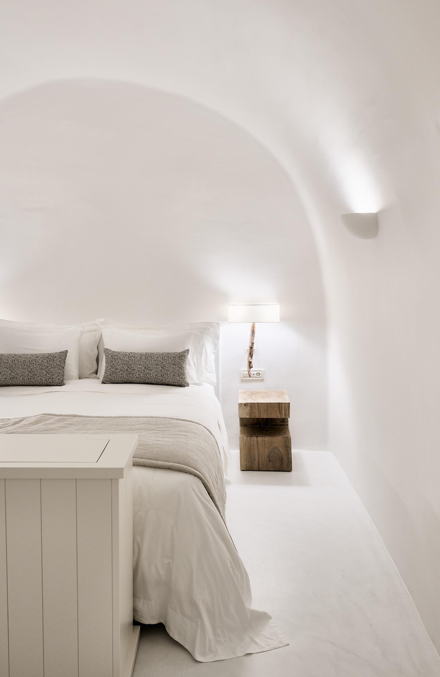 Cave in luxury bedroom of Mystique Hotel in Santorini