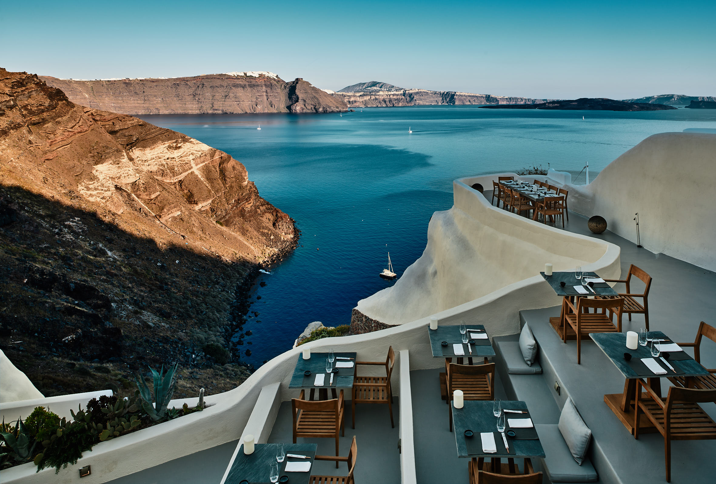 Charisma Restaurant with panoramic views of the infinity-edge pool and the blue of the Aegean Sea