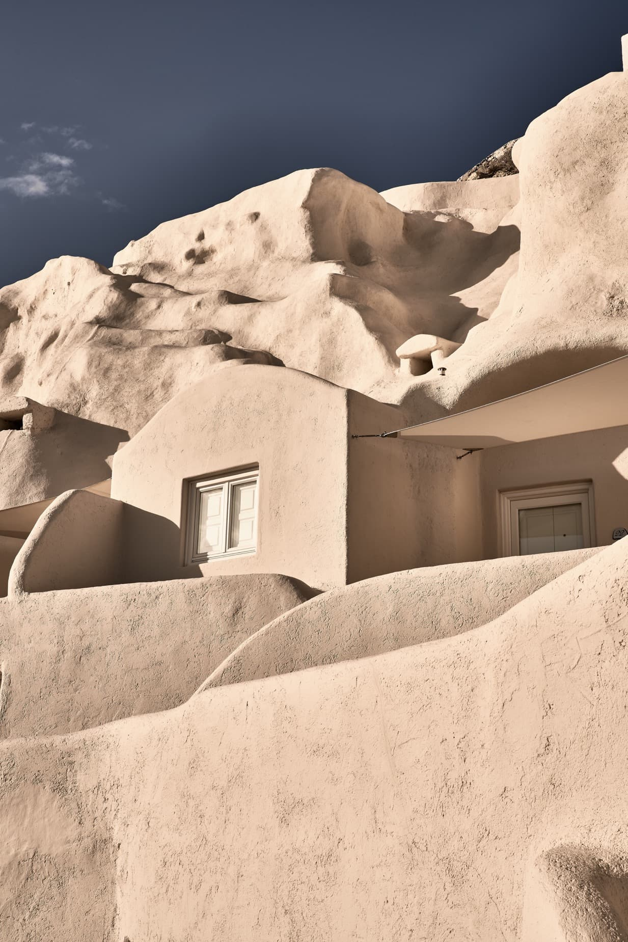 Mystique's 41 suites and villas are carved into the rugged caldera cliffs of Oia