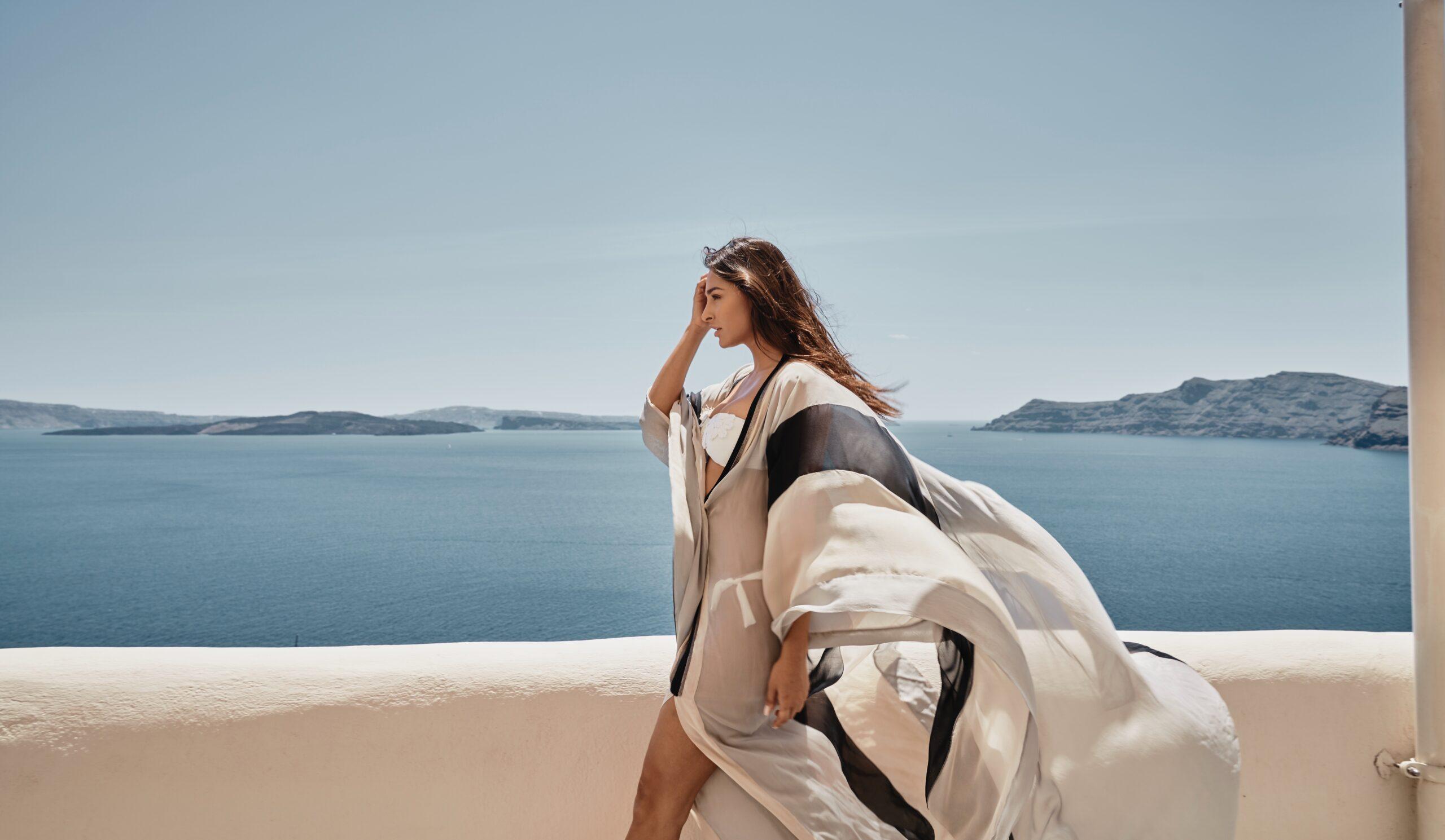 Woman waliking outside Elios Spa of Mystique Hotel