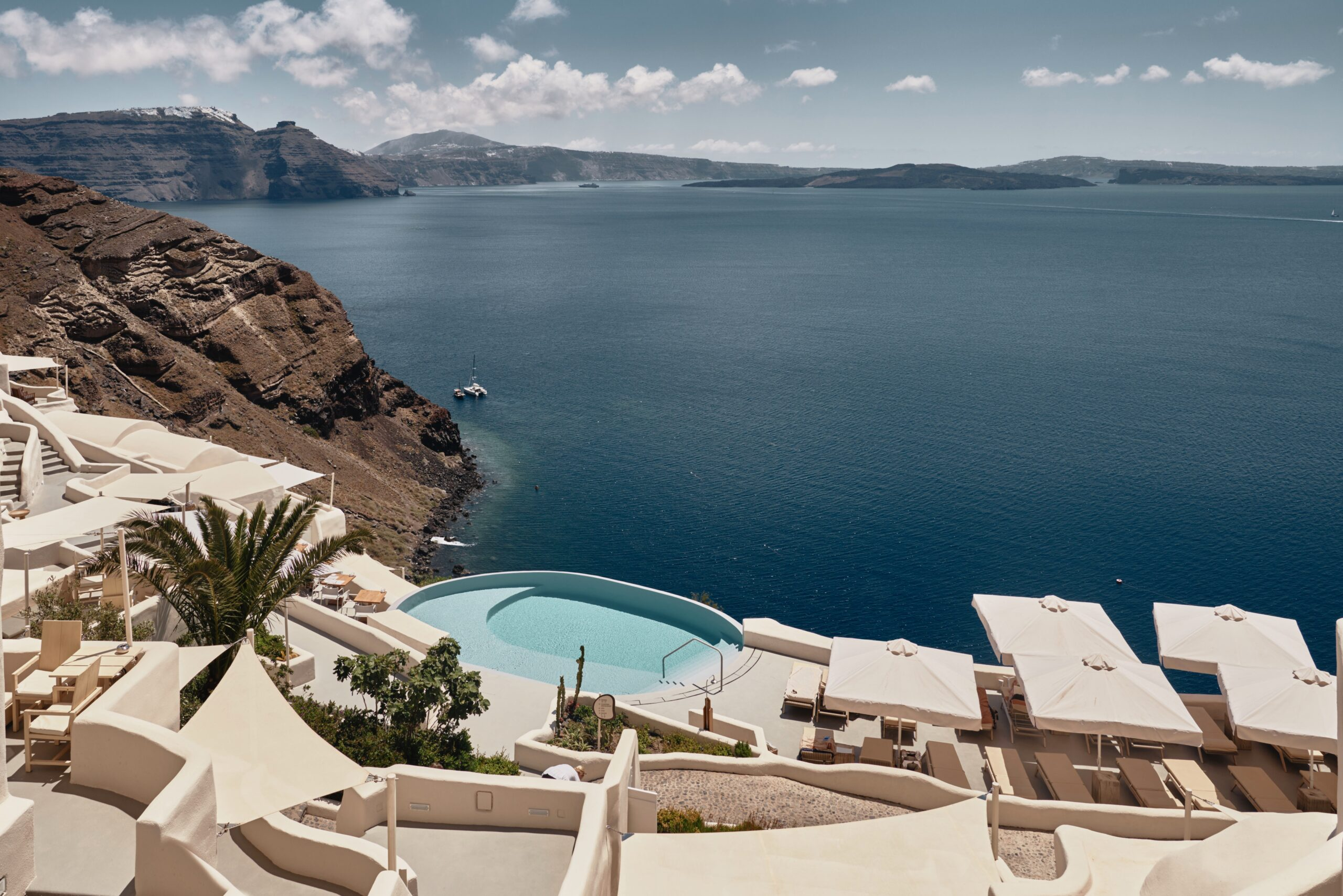 Mystique hotel overview overlooking the deep blue of the Aegean Sea