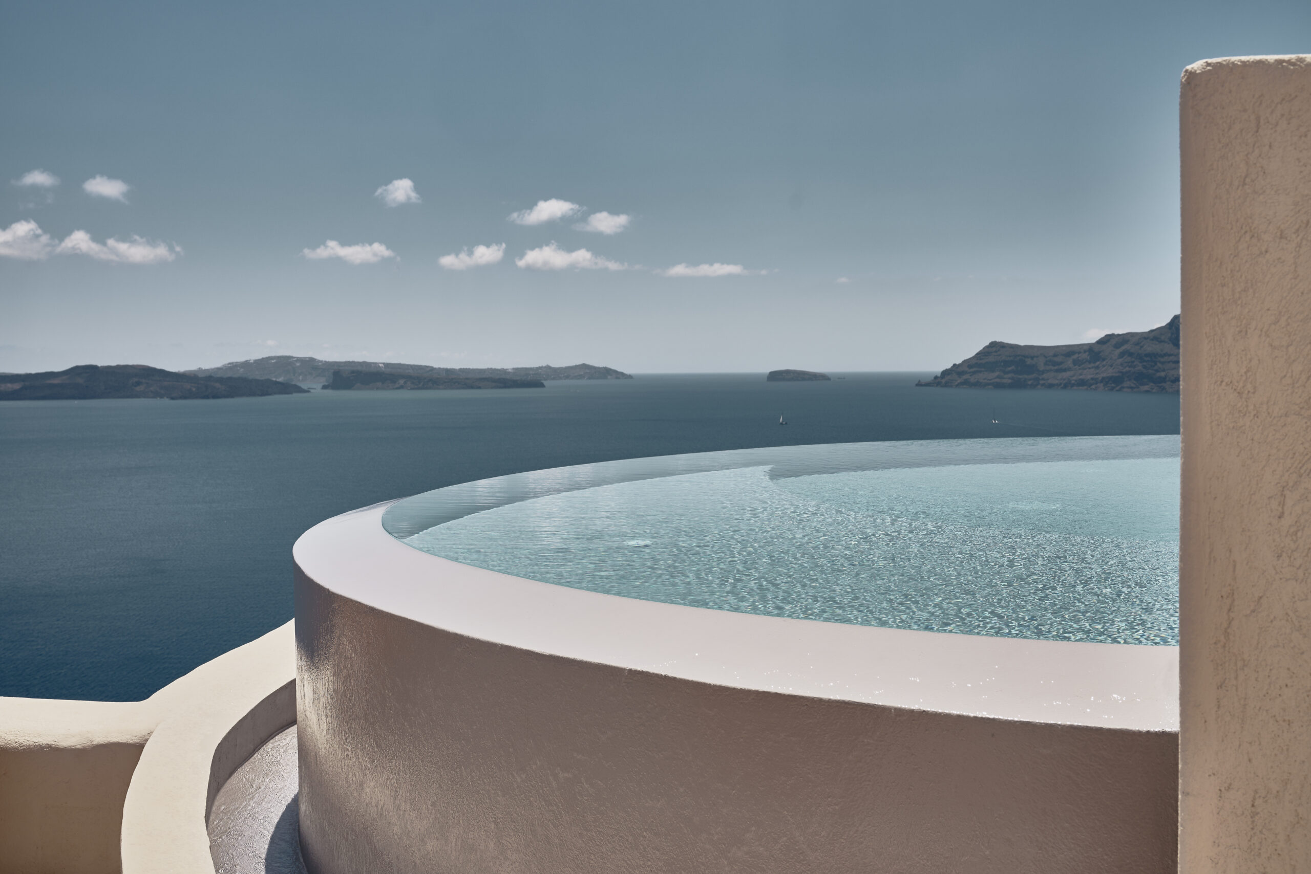 Private infinity pool hanging from the cliffs of caldera