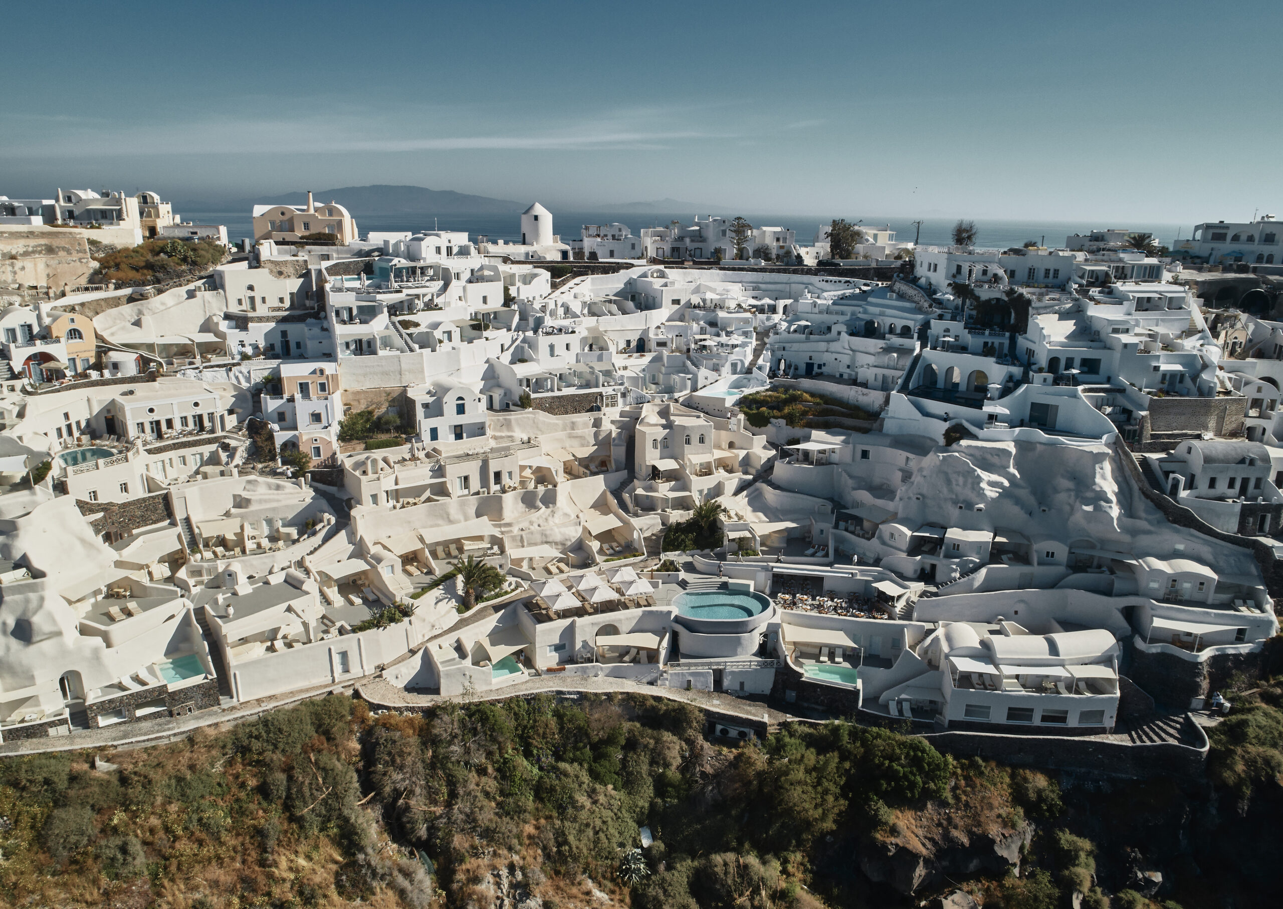 Mystique Hotel hanging from the steep cliffs of caldera in Santorini