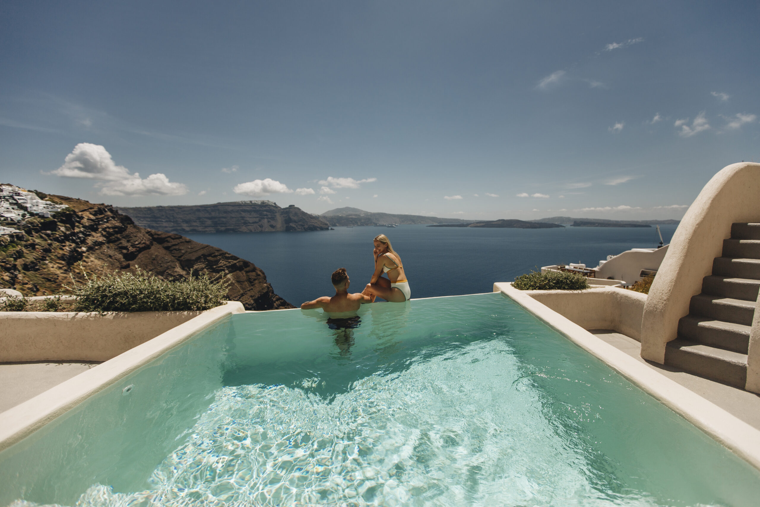 Couple in the Hollistic Villa private infinity pool enjoying the breathtaking view