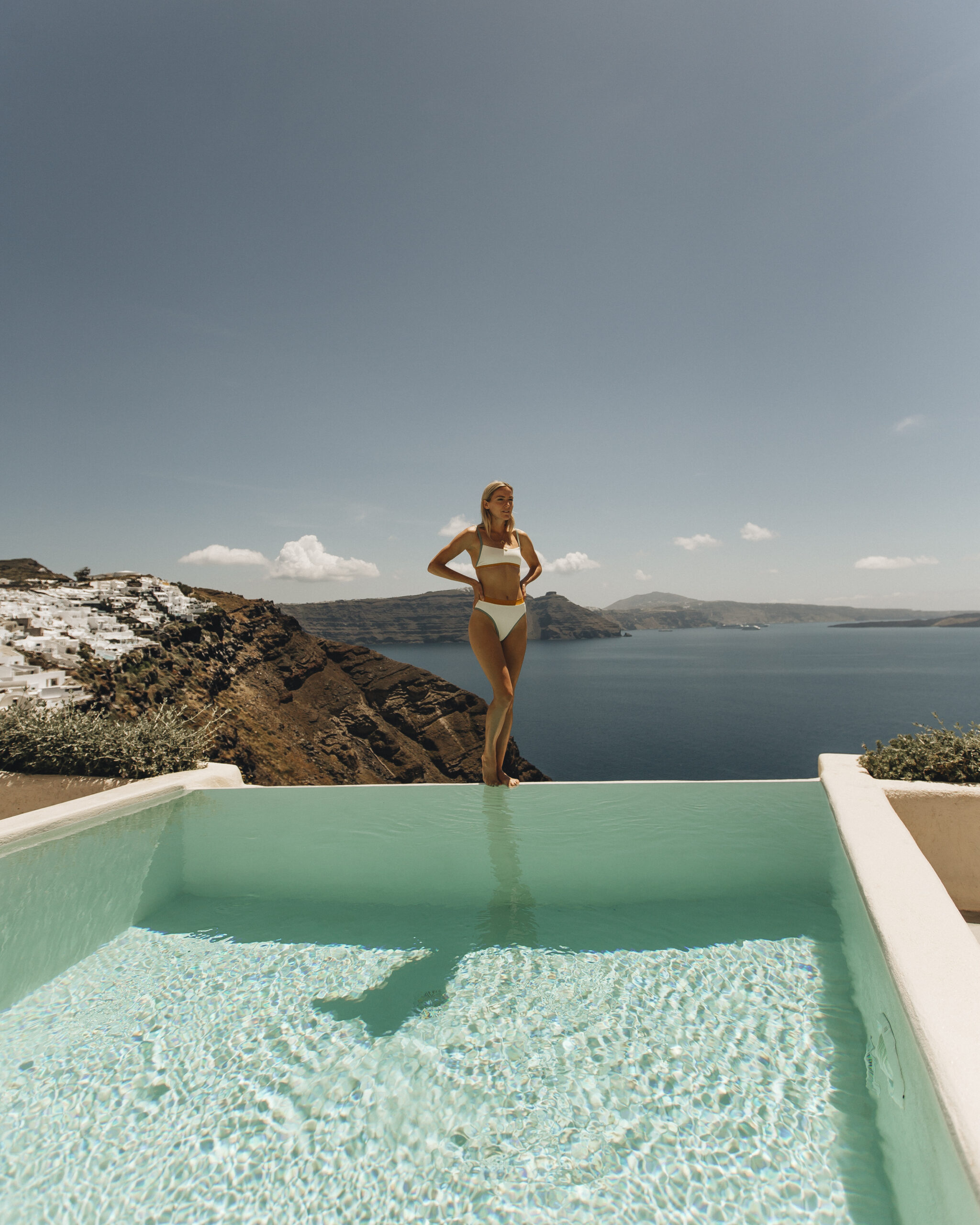 Girl standing by the private infinity pool of Hollistic villa