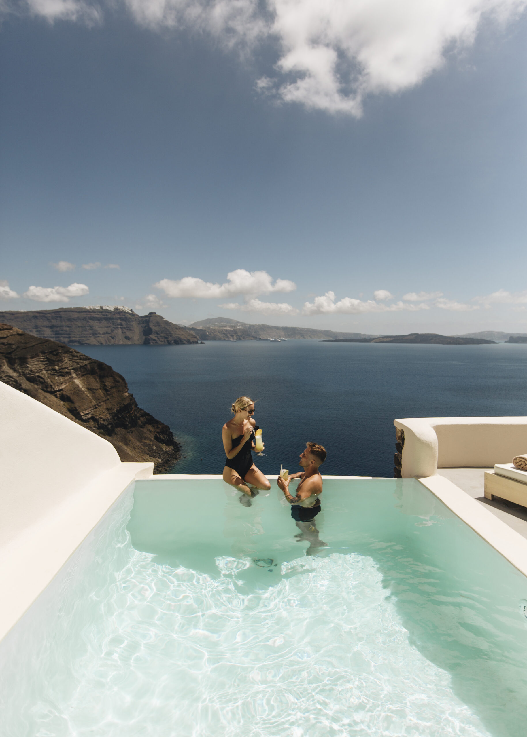 Couple enjoying holidays in the private infinity pool of Hollistic Villa at Mystique Hotel