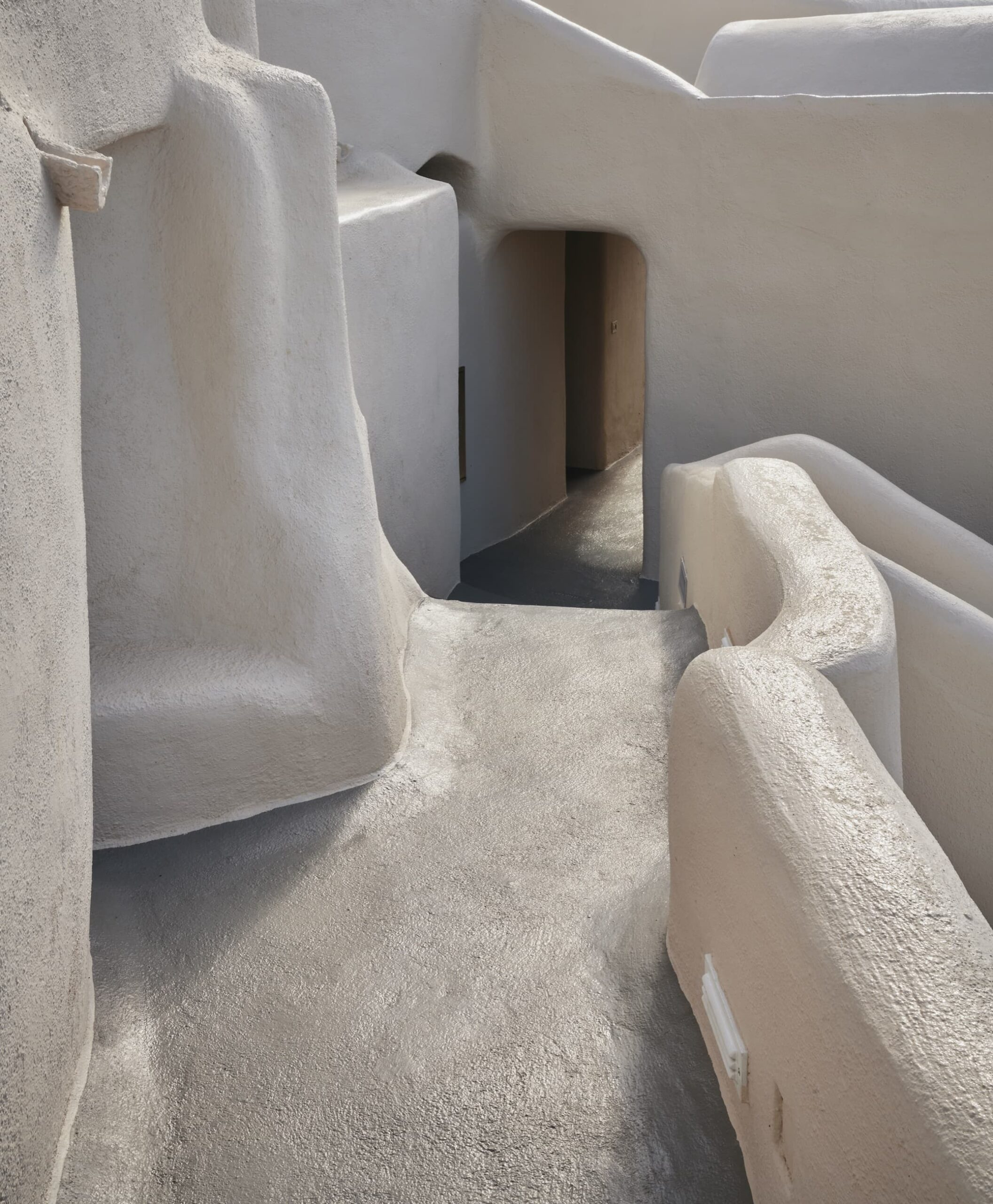 Public spaces of Mystique Hotel in Santorini with whitewashed alleys
